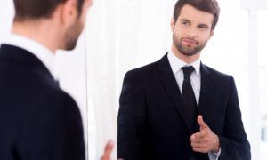 Man in suit, mirror, gender bias