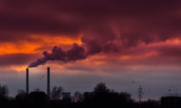 smoke from coal-powered plant stacks