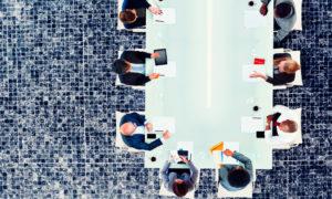 boardroom meeting with diverse board members