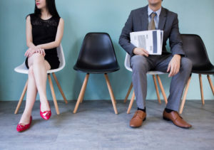 woman and man waiting for interview