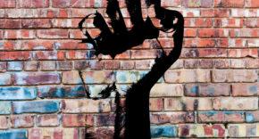 revolutionary fist graffiti on wall