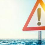 Warning sign alerting climate risk