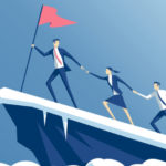 Team climbing a mountain using collaborative leadership