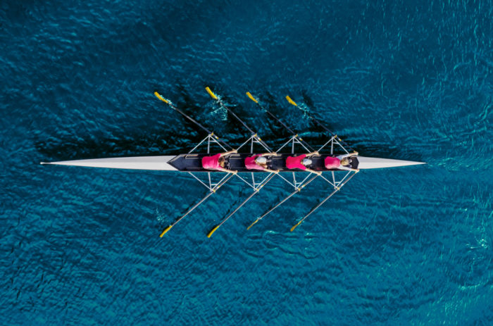 a rowing team on a river