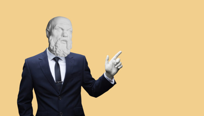 Socrates wearing a business suit