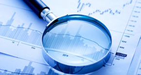 Magnifying glass on audit documents