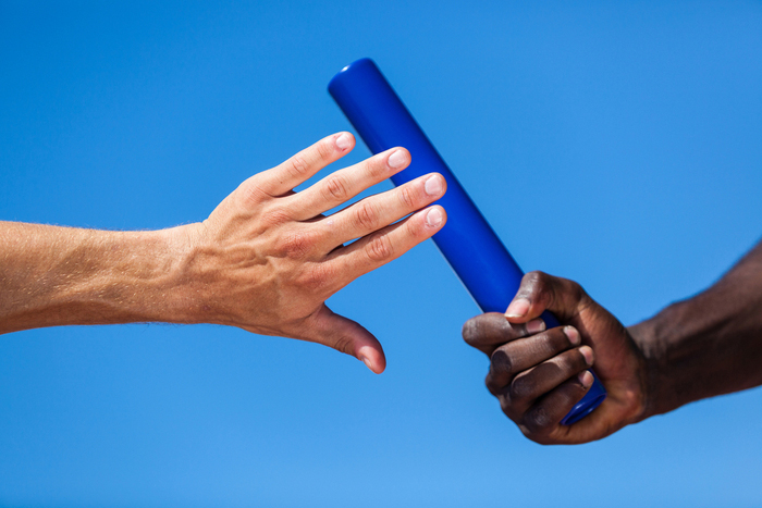 Athletes passing the baton
