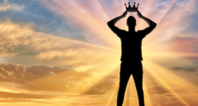 A narcissistic leader places a crown on his own head