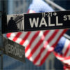 US flag flying on Wall Street