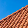 Red roof tiles against a blue sky