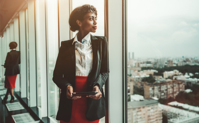 Black businesswoman looking out over the city