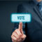 Businessman voting electronically