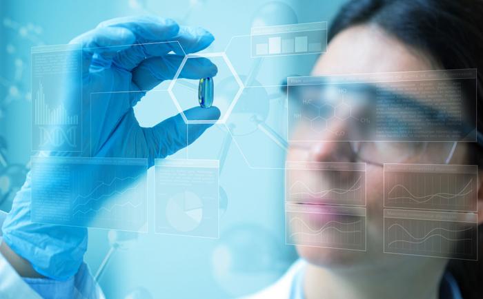Scientist examines pill