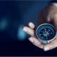 Businessman holding a compass