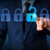 Businessman pressing a cybersecurity lock