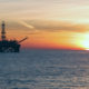 Offshore oil and gas rig at sunset