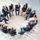Internal meeting with colleagues sitting in a circle