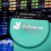 Deliveroo website in front of stock exchange board