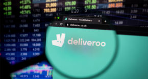 Deliveroo website in front of stock exchange board