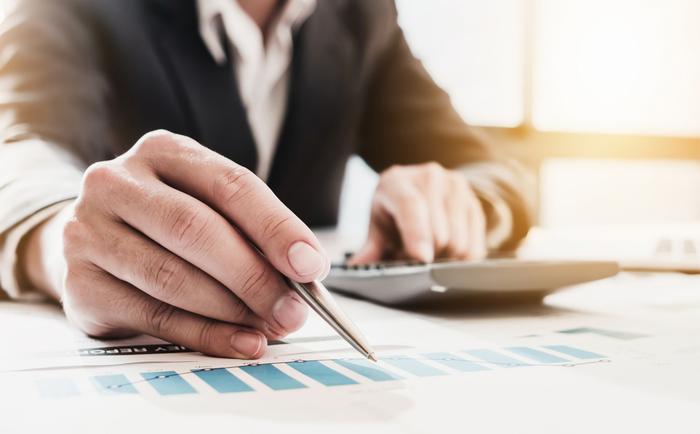 Businessman looking at audit figures