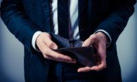 Businessman looking in his wallet