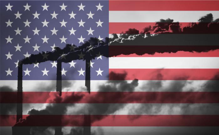 US flag behind polluting factories
